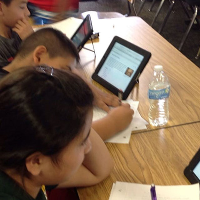 Students use tablets to broaden their understanding of in-class topics!