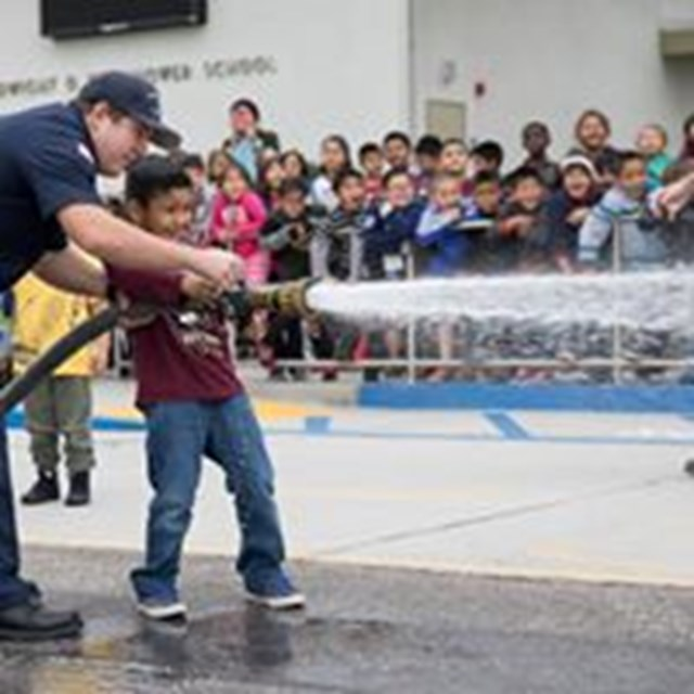 Firefighters teaching our kids how to put out fires!